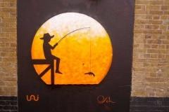 Extreme Fishing, Stencil graffiti on wall Rivington Street, Shoreditch, London March, 2014
