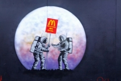 I'm Luvin It, Stencil graffiti on wall, New Oxford Street Westminster, London February, 2014