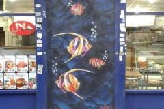 Something Fishy going on,Stencil graffiti on shopfront Brick Lane, London 2014