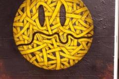 Thames Smiley, Stencil graffiti on wall Brick Lane April, 2014